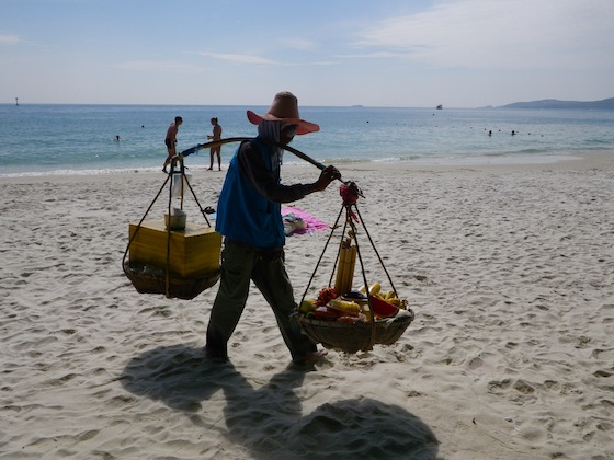Thai people selling fruits, boiled eggs and grilled chicken on the beaches