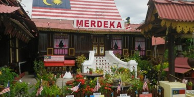 Wooden house of Melaka with the Malaysian flag painted on the roof